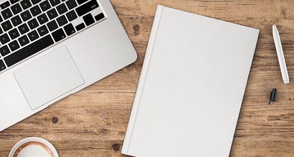 ordinateur et carnet